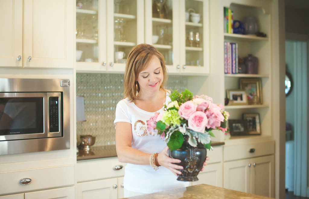 Marquette readies a kitchen for a photo shoot with one of her floral designs.  |  Photo by Dunlap Portrait
