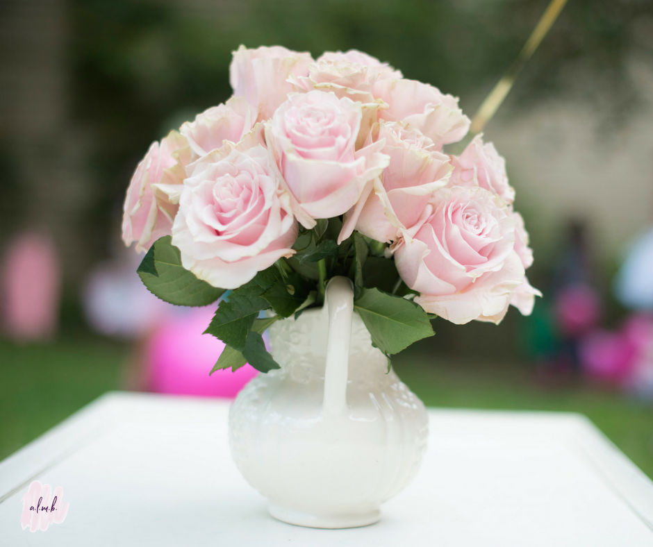 Simple pink roses adorned the tables on the lawn. || A Life More Beautiful