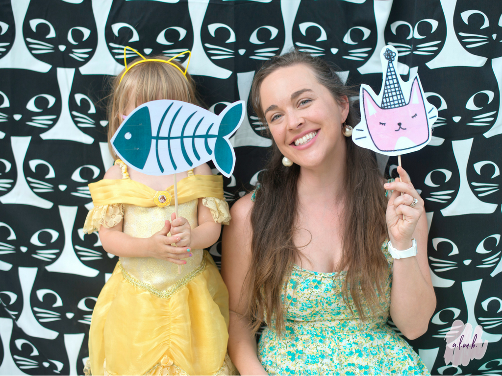 Parents and kids alike had fun posing in front of the photo booth. | A Life More Beautiful
