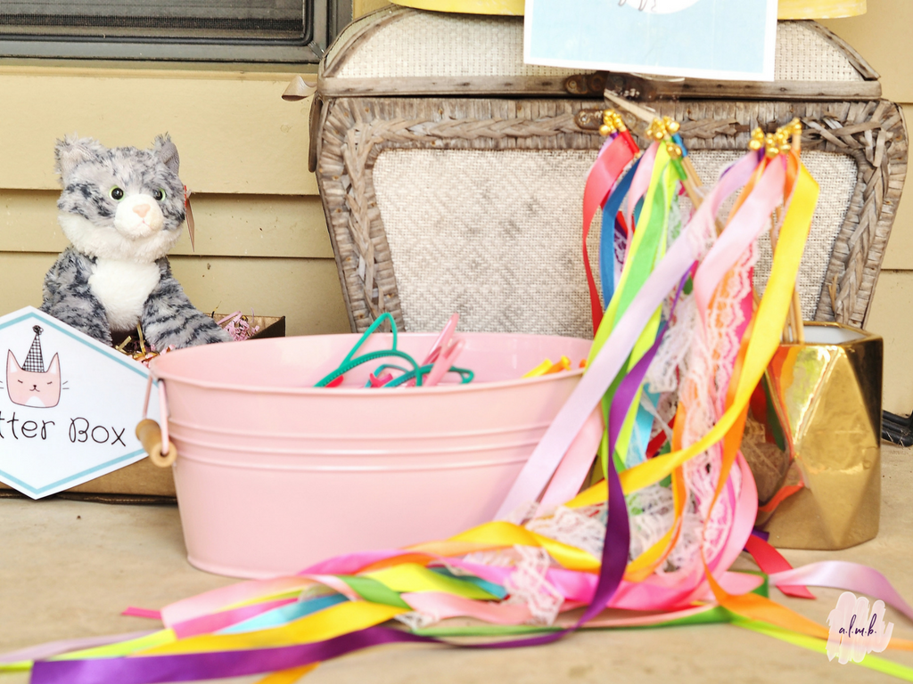 Plastic kitten ears and ribbon wands helped the children get in the pretty kitty spirit. | ALMB