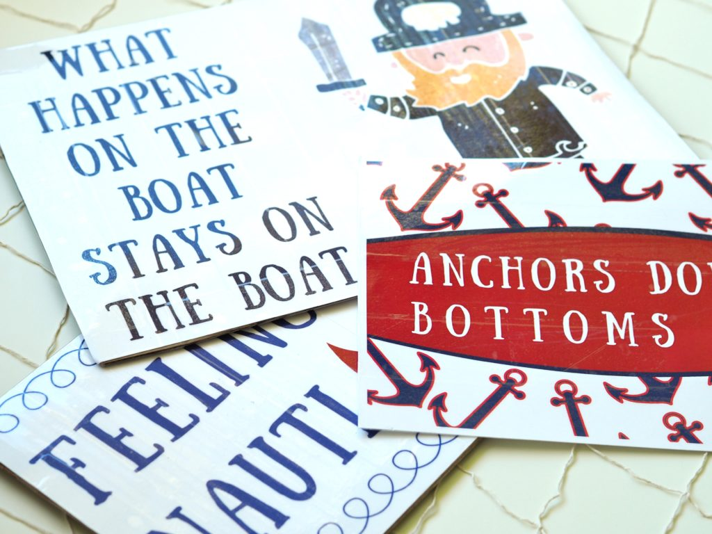 A Life More Beautiful designed photo props with festive nautical sayings.