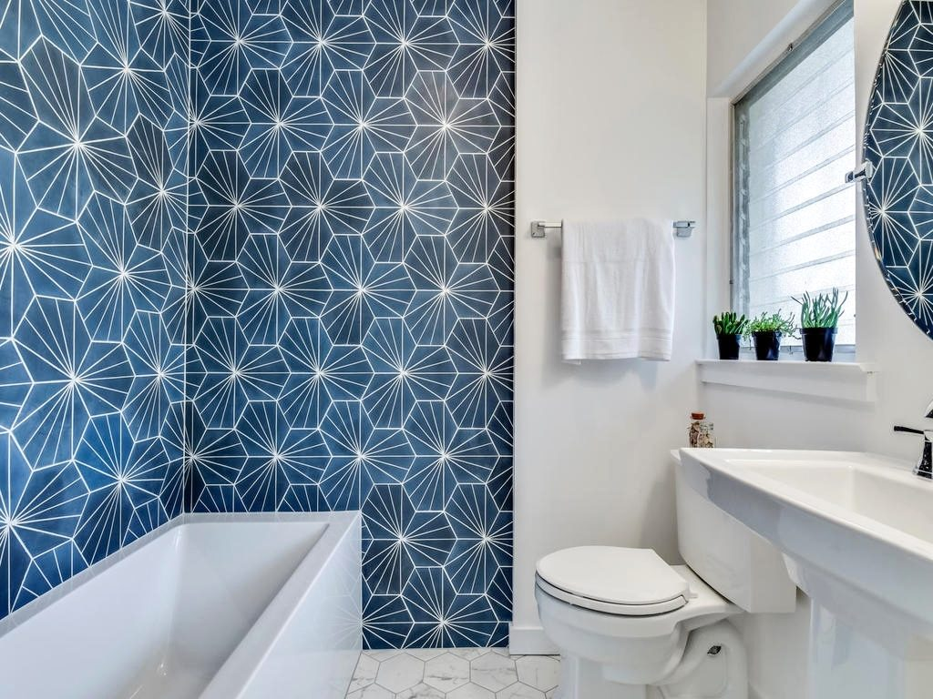 Bold, geometric tile is hot in Austin home interiors this year. Design by A Life More Beautiful