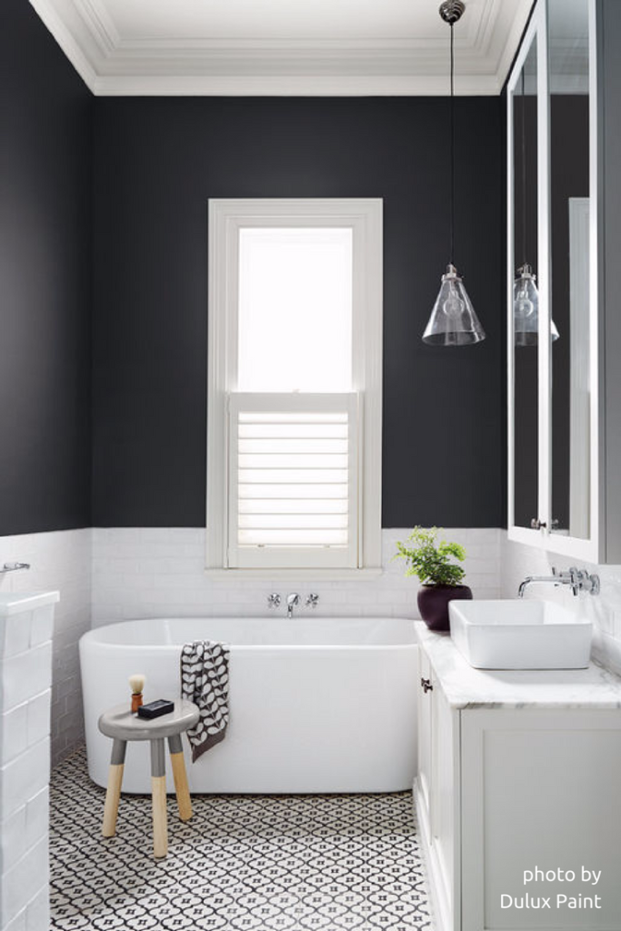 The dark walls add sophistication to this bathroom by Dulux Paint.